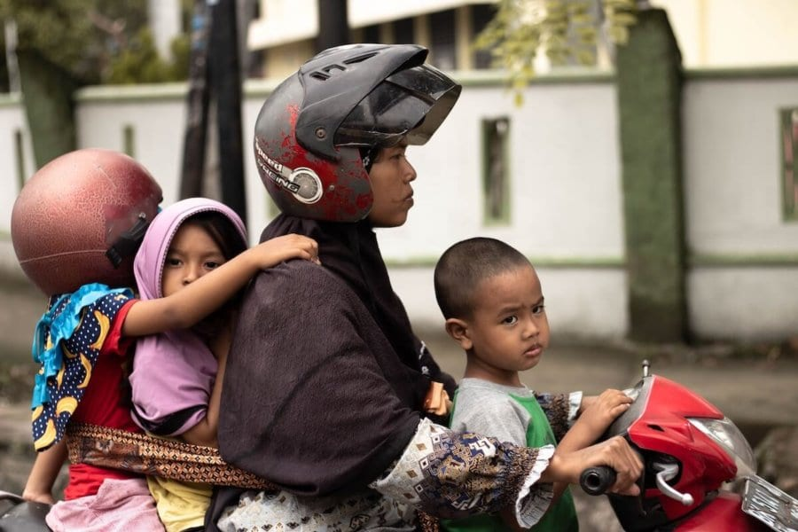 Kids without helmet on a scooter