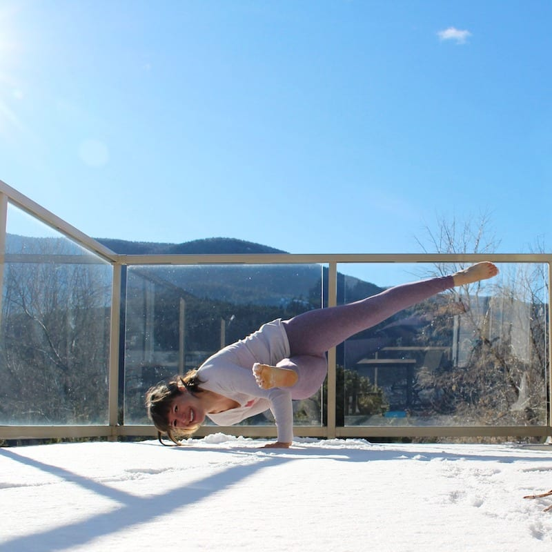 girl doing yoga in the snow