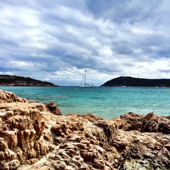 Corsica, France. Sailboat on turquoise water