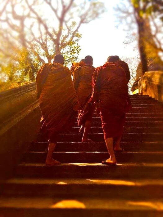 Daily scenes of monks walking up the stairs for an Expat in Chiang Mai