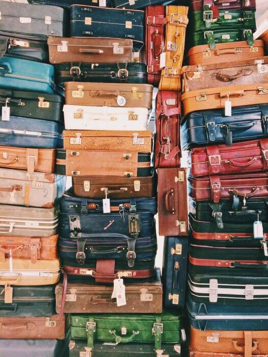 stack of suitcases moving to Malaysia