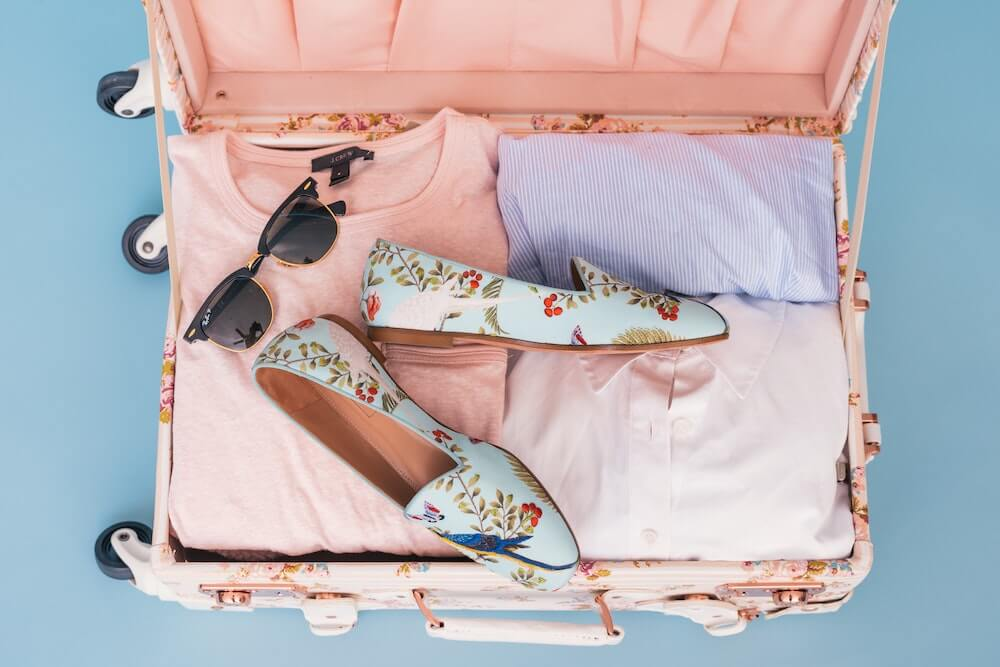 floral pink suitcase, blue floral shoes Moving to Malaysia