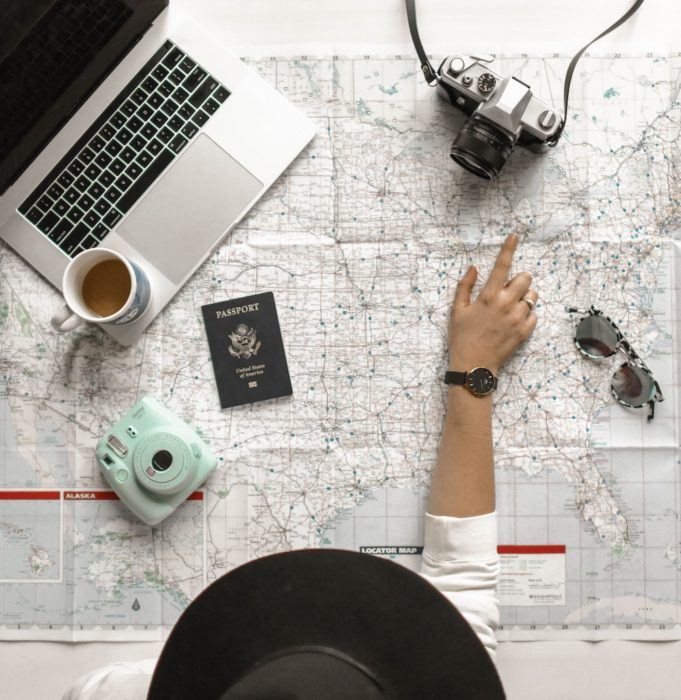 map, passport, camera, computer:checklist for moving abroad