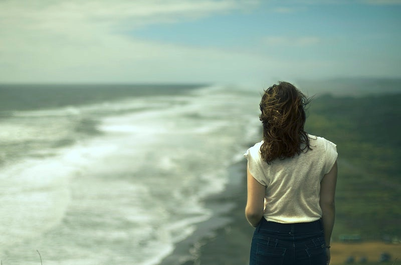 back of girl looking at the sea