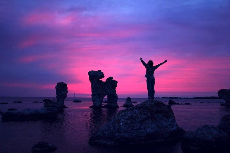happy woman silouette purple sunset: its ok to move away from family
