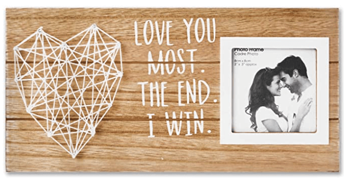Wooden picture frame with string heart that reads Love you Most. The end. I win.