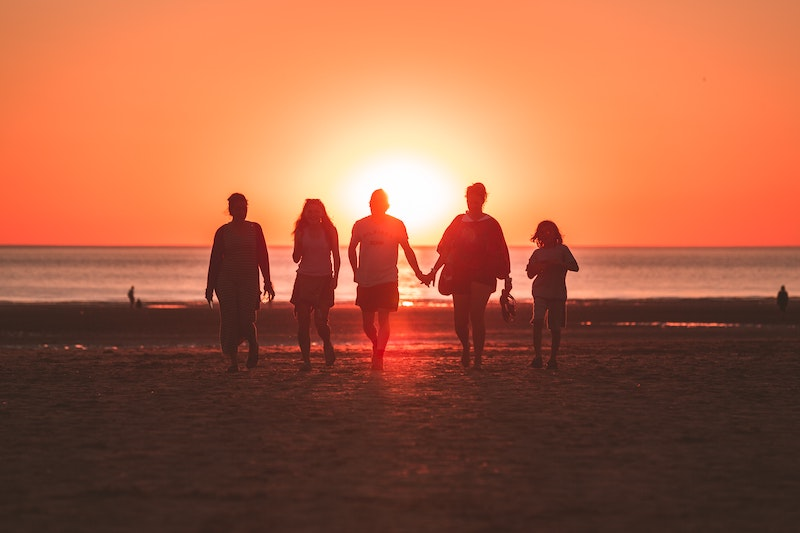 group of friends in sunset